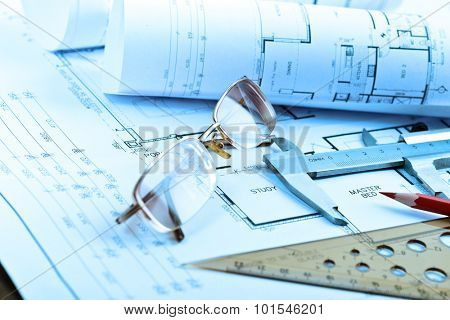 Architectural blueprints rolls and engineering items. Toned in blue