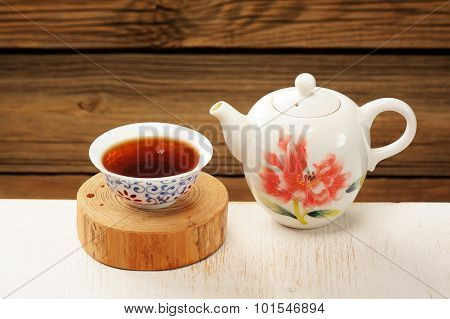 Puerh Tea In White Bowl Brewed In White Porcelain Pot