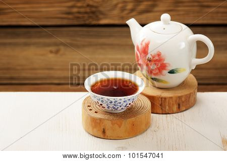 Ripe Puerh Tea In White Bowl Brewed In White Porcelain Pot