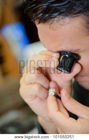 Jeweller assessing a stone
