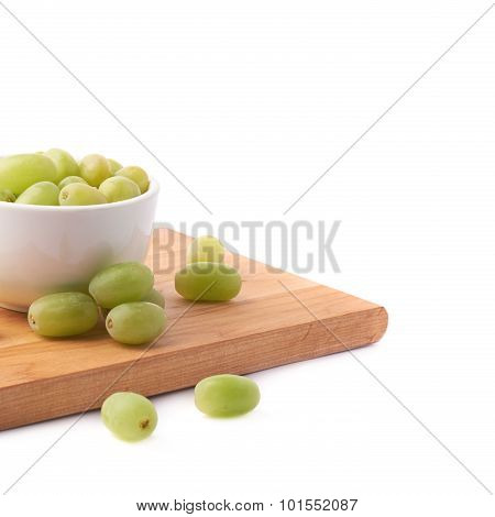 White grapes in a ceramic bowl isolated