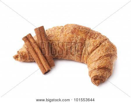 Croissant pastry and cinnamon sticks