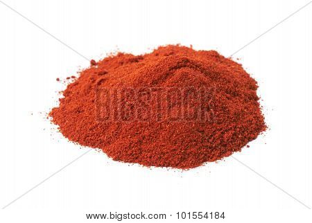 Pile of red paprika powder isolated