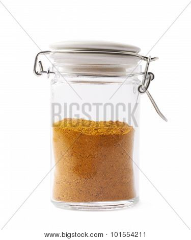Glass jar filled with curry powder