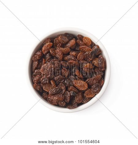 Cup filled with raisins isolated