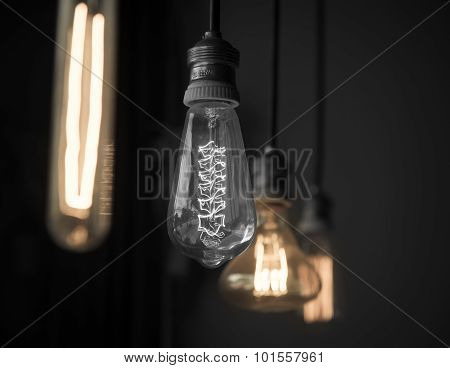 Hanged Light Bulbs Black And White One And Colored On Others