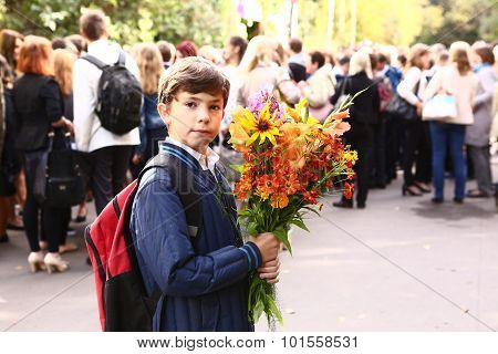 Boy With Flowers Celebrate First School Day In Moscow.