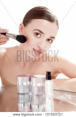 Beautiful Girl Applying Powder By Brush On Her Face.