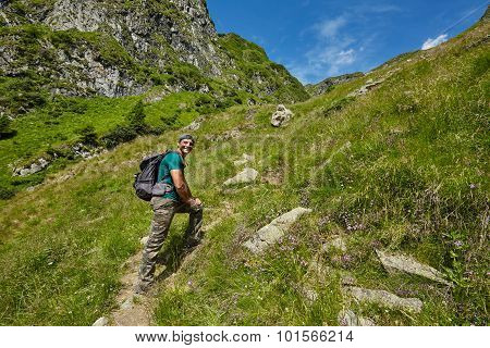 Hiker Walking To The Mountain Peak