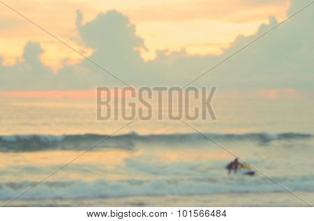 Blur Men Playing Jet Ski On Tropical Sunset Beach Abstract Background.