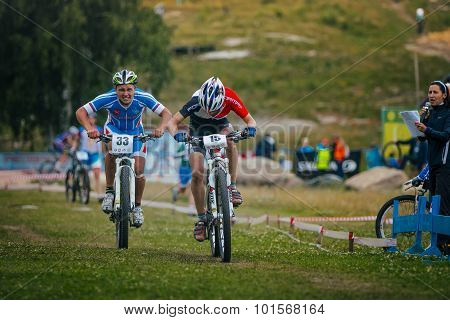 two cyclists competing at the finish
