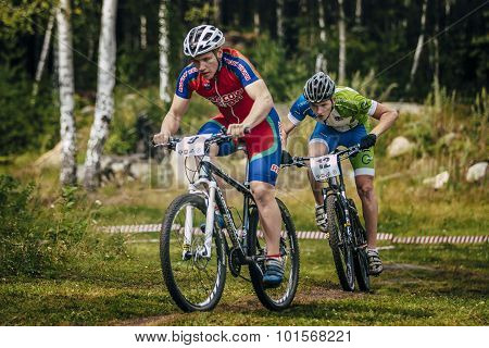 two cyclists compete