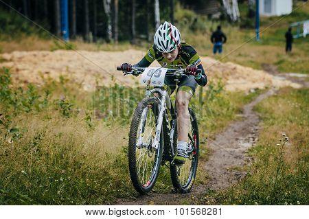 girl on mountain bike uphill
