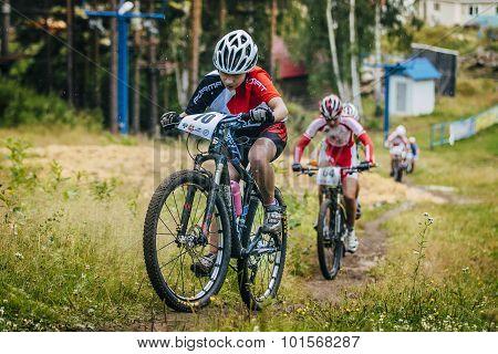 group girls on mountain bike uphill