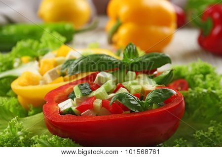 Fresh green salad in pepper on table close up