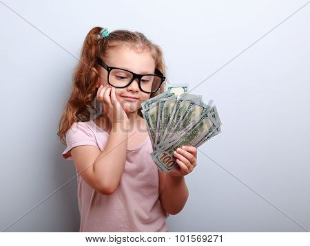 Dreaming Cute Kid Girl Looking On Money And Thinking How Can Spend Its