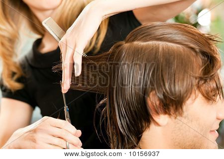 Man receiving haircut