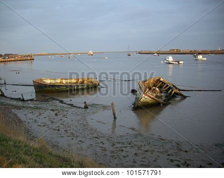 Derelict boats on the edge of a river