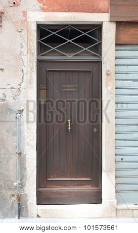 Wooden door in wall