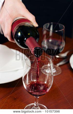 Waitress refills glass