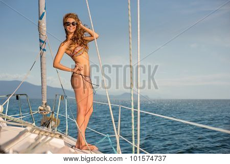 Girl resting on the yacht.