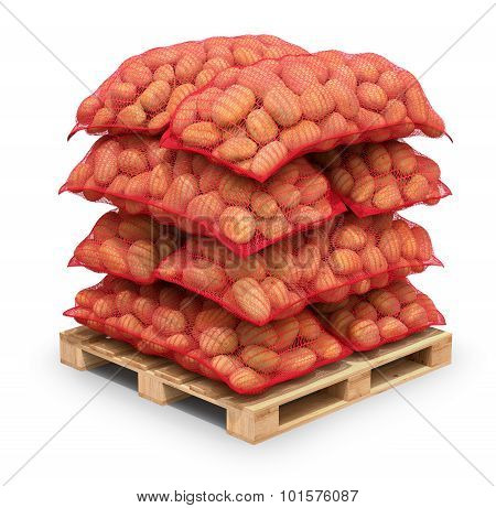 Potatoes in burlap sacks on the pallet