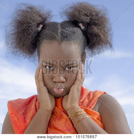 Afro girl making a face, ten years old