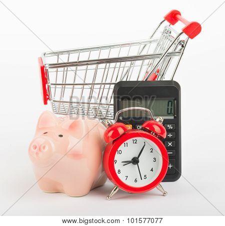 Piggy bank, calculator and shopping cart