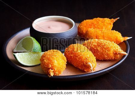 Fried breaded surimi crab claw.