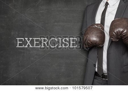 Exercise on blackboard with businessman on side