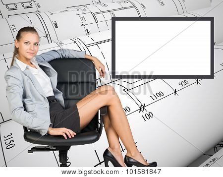 Business lady sitting in relaxed posture