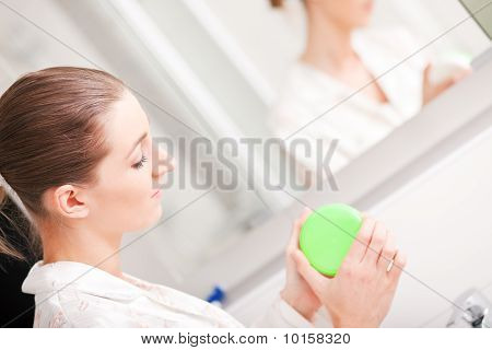 Woman opening cream container