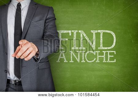 Find a niche on blackboard with businessman
