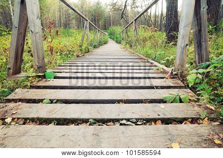 narrow rope pedestrian bridge