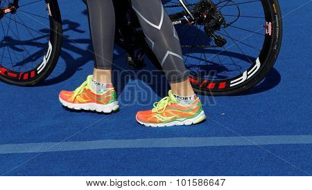 Shoe's Of A Triatlete And Bicycle Wheels