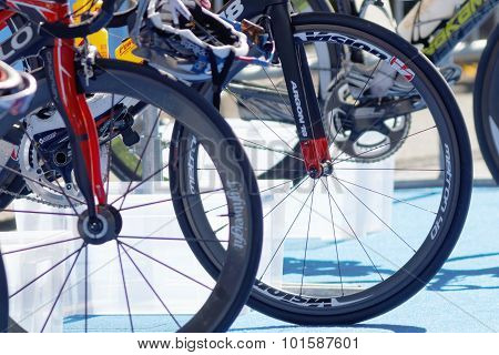Lots Of Bicycle Wheels On Triathlete Bicycles