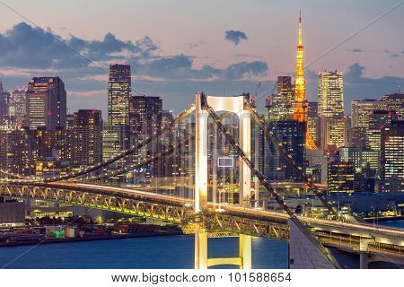 Tokyo Tower skyline and Rainbow Bridge with cityscape at Odaiba Japan