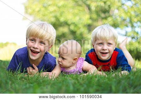 Three Happy Young Children Laughing Outside