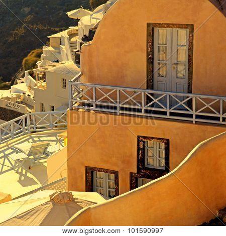 Buildings Of Oia Village At Sunset, Santorini Island, Greece