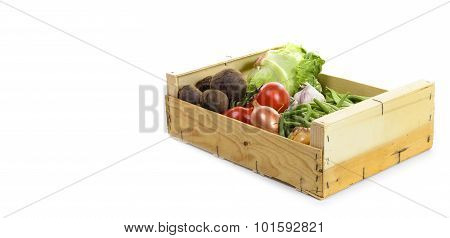 Wooden Crate With Seasonal Vegetables On White Background