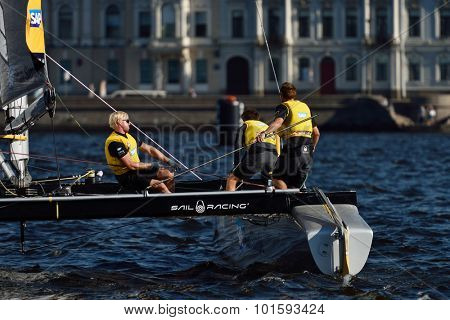 ST. PETERSBURG, RUSSIA - AUGUST 22, 2015: Catamaran of SAP Extreme Sailing Team of Denmark during 3rd day of St. Petersburg stage of Extreme Sailing Series. The Wave, Muscat team leading after 2 days