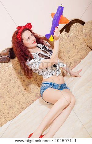 Photo of seductive  young funny redhead girl playing with toy