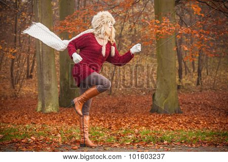 Fashion Woman Running In Fall Autumn Park Forest.