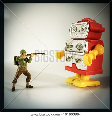 Vintage style Toy Soldier shooting at retro plastic robot - Instagram filtered