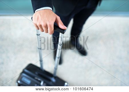 Man's hand with a suitcase