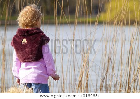 Little girl ashore of river