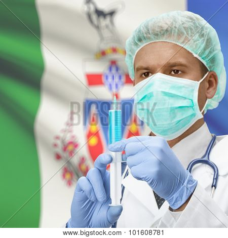 Doctor With Syringe In Hands And Canadian Province Flag On Background Series - Yukon