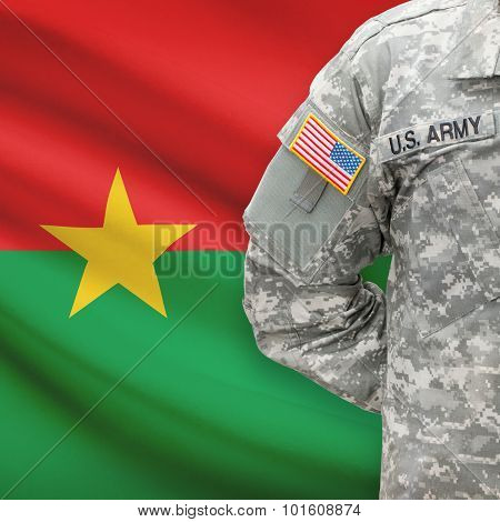 American Soldier With Flag On Background - Burkina Faso