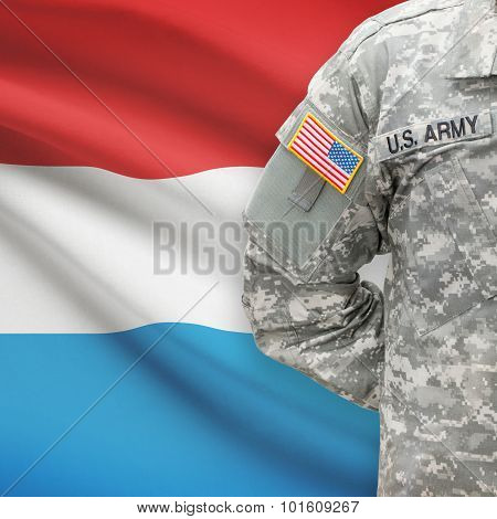 American Soldier With Flag On Background - Luxembourg