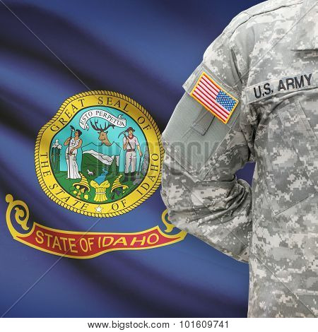 American Soldier With Us State Flag On Background - Idaho